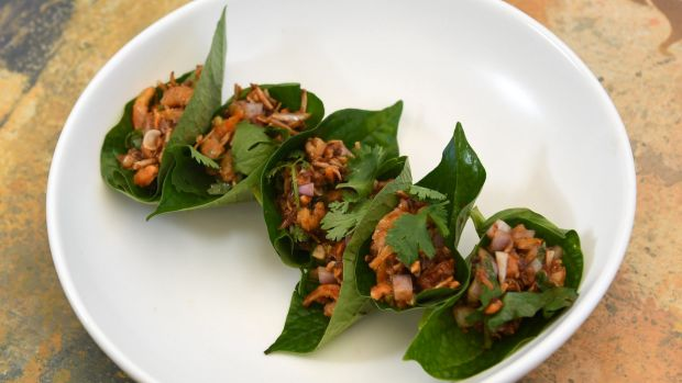 The dried prawns with ginger and toasted coconut in betel leaves served at Long Chim Thai restaurant.