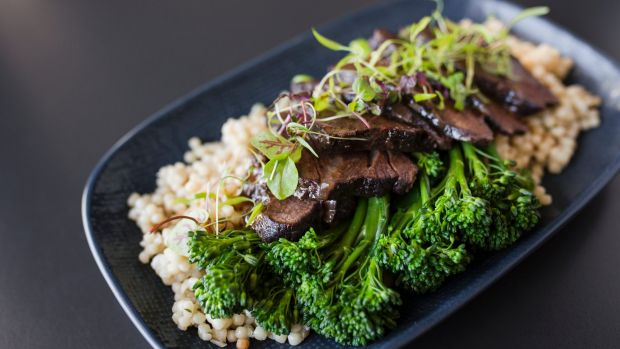 Angus beef cheeks are 12 hours braised, with pearls of cous cous, and broccolini.