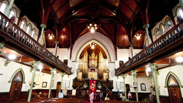 The deep cedar timbers and vaulted timber ceilings attracting international tourists to the Albert Street Uniting Church.