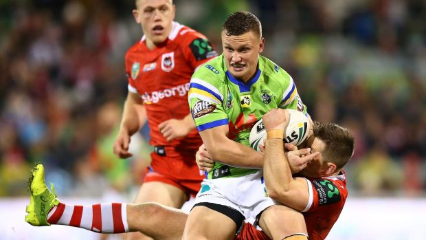 Jack Wighton, of the Raiders, is tackled during match against St George Illawarra Dragons.