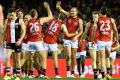 Tom Bellchambers  is congratulated by teammates after kicking a goal against St Kilda at Etihad Stadium on Friday night.
