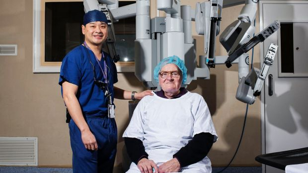 Dr Ronald Chin with patient Brian Hodge who was spared six months of recovery and disfiguring scars following robotic ...