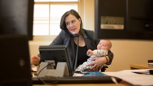 Kelly O'Dwyer at work with her son Edward.