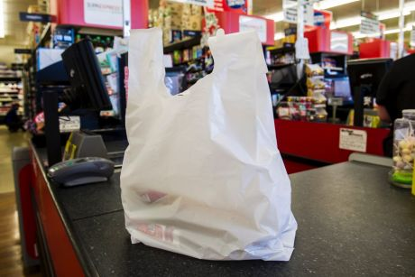 Coles, Woolworths and Harris Farm produce about 80 per cent of the plastic bags in NSW, the Premier says.