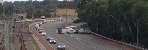 A forensic tent was set up by homicide detectives on the Mitchell Freeway on Saturday after the discovery of a woman's body.
