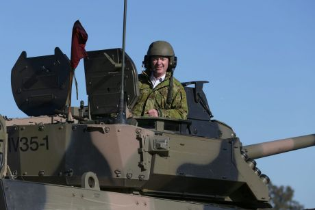 Defence Industry Minister Christopher Pyne, in the turret of an armoured vehicle at Victoria's Puckapunyal army base ...