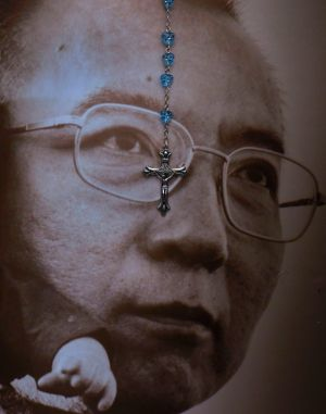 A rosary hangs over the portrait of the late Chinese Nobel Peace laureate Liu Xiaobo in Hong Kong.