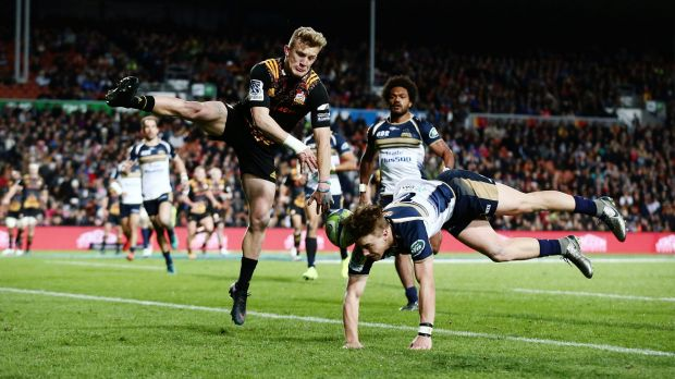 Damian McKenzie flies high against Jordan Jackson-Hope.