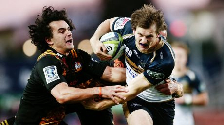 HAMILTON, NEW ZEALAND - JULY 15: James Dargaville of the Brumbies on the charge against James Lowe of the Chiefs during ...