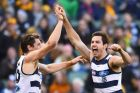 Daniel Menzel of the Cats is congratulated by Mark Blicavs after kicking a goal.