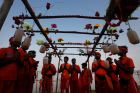 Indian Hindu Kanwarias, worshippers of Hindu God Shiva, offer prayers after taking holy dips in the Ganges River in ...