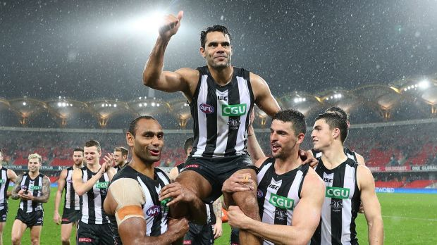 Collingwood's Daniel Wells  is chaired the field after his 250th match, which turned out to be a nail-biting 15-point ...