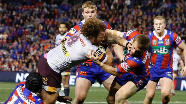 Muscling up: Korbin Sims pushes past the Knights defence to score for the Broncos.