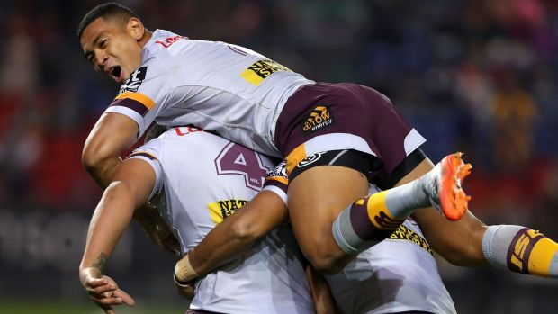 Jubilant: Jamayne Isaako celebrates another Broncos try.