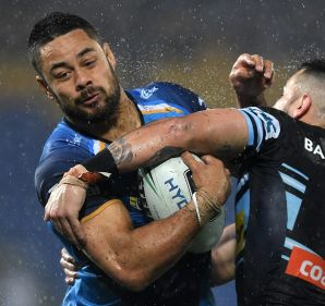 Titans player Jarryd Hayne (left) competes with Sharks player Jack Bird during the Round 19 NRL match between the Gold ...