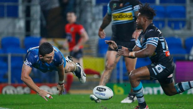 Dominant performance: Ash Taylor scores another Titans try.