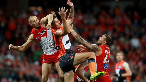 Marking duel: Rory Lobb of the Giants competes against Sam Reid and Lance Franklin.