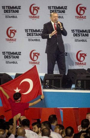 Turkish President Recep Tayyip Erdogan speaks to the crowd in Istanbul in front of the logo created to mark the date of ...