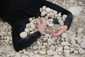 Linda Luke headless in the stones during Platform 2017 at Articulate Project Space.