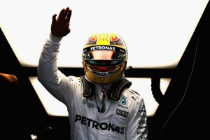 Pole position: Lewis Hamilton waves to the crowd.