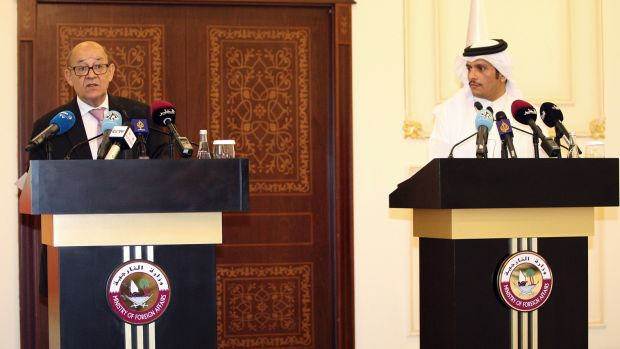 French Foreign Minister Jean-Yves Le Drian, left, at a news conference with his Qatari counterpart Mohammed bin ...