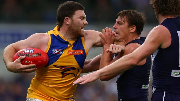Fend off: West Coast's Jeremy McGovern clashes with Nick Suban.
