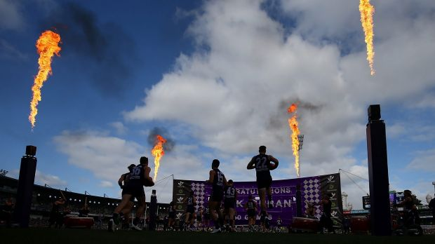 Stage set: The Dockers run onto the field for the final Western Derby at Domain Stadium.