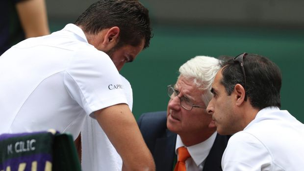Marin Cilic has treatment on his foot as he takes a medical timeout during the Wimbledon final.