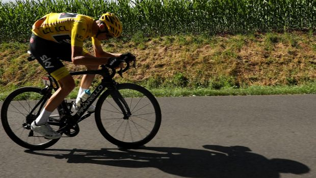 Under pressure: Chris Froome survived a tough day in the saddle.