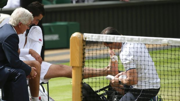 Marin Cilic receives treatment on his foot during a medical timeout in the Wimbledon final.