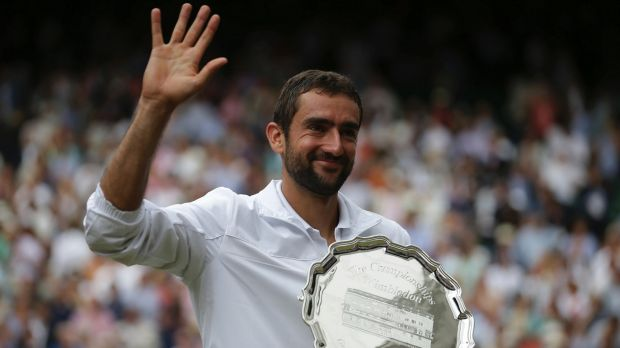 The smile returns: Marin Cilic holds the runners-up trophy.