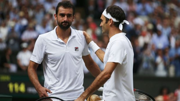 Roger Federer and Marin Cilic shake hands after Federer won in straight sets.