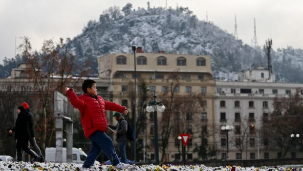 Record cold temperatures and an unusual snowfall hit Chile's capital Saturday. Normal temperatures are expected to ...