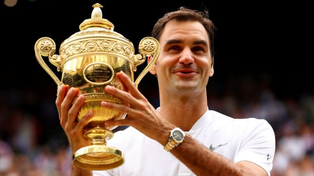 Roger Federer enjoys the spoils after winning his eighth Wimbledon title.