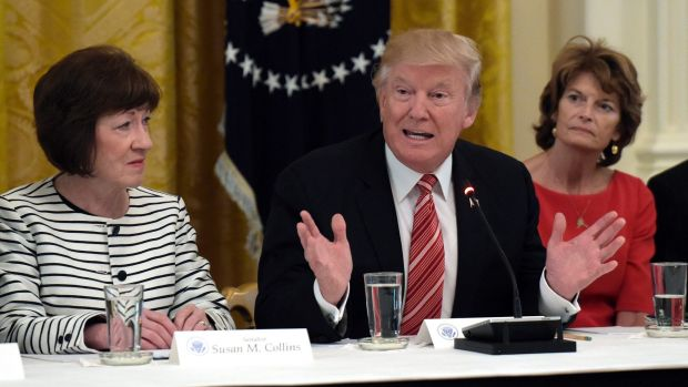 US President Donald Trump, centre, meets with Republican senators on healthcare in June, Republican Senator Susan ...