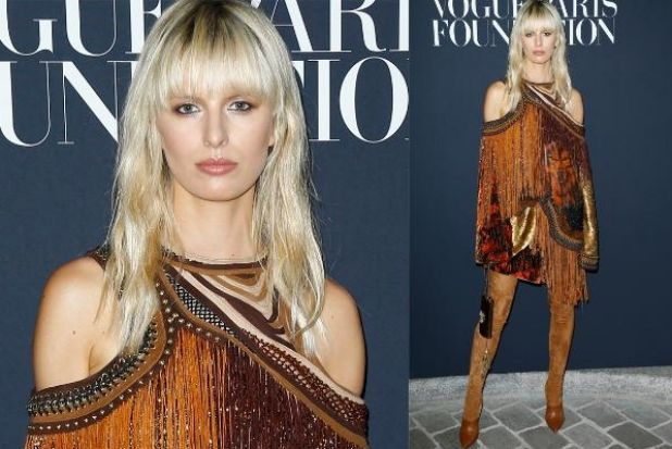 There's fringing, there's beading, there's velvet, there's a, er, lone wolf… in fact the only thing this Balmain dress ...