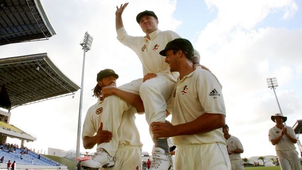 Stuart MacGill is chaired from the ground by Andrew Symonds and Mitchell Johnson after his final Test, in 2008 in the ...