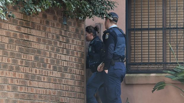 NSW police officers at the family home of Justine Damond in Freshwater, Sydney.