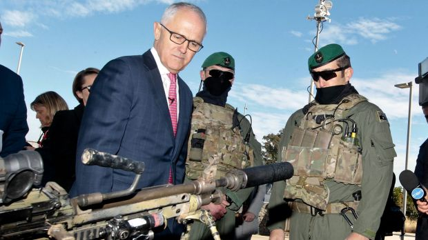 Prime Minister Malcolm Turnbull examines some military hardware during a media conference at Holsworthy Barracks on Monday.