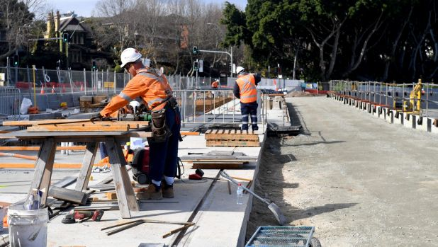 Construction workers at a stop for the light rail line on Wansey Road near Randwick Racecourse.