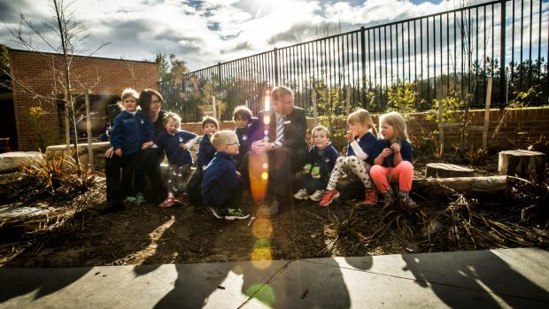 St Anthony's Parish Primary principal Greg Walker and Early Learning Centre director Sharon O'Brien with some of their ...