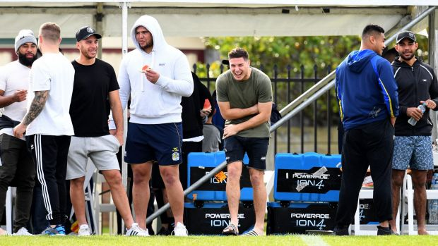 Tiger talk: Mitchell Moses shares a laugh with teammates on Monday.