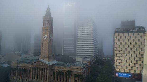 Thick fog formed over Brisbane early on Tuesday, delaying public transport.