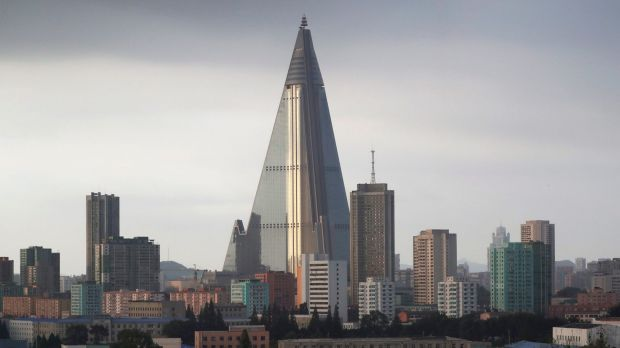 The sky is overcast at the end of a work day in Pyongyang, North Korea, where the 105-storey pyramid-shaped unfinished ...