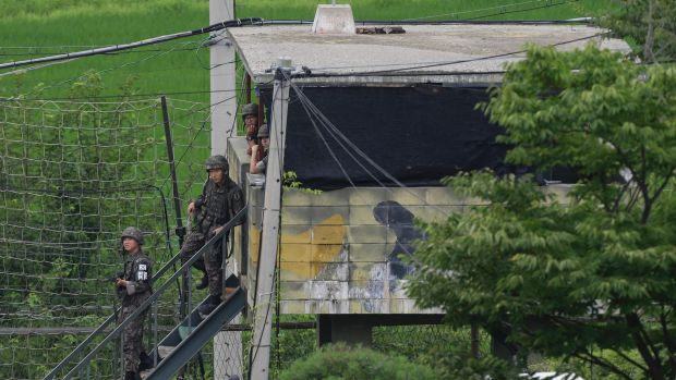 South Korean army soldiers step down from a military guard post in South Korea's Paju on Monday.