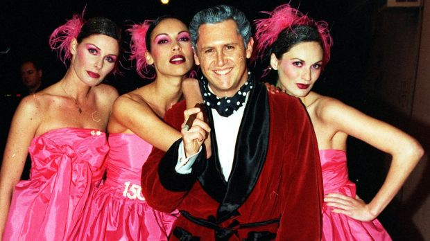 Game show host Larry Emdur channelled Hugh Hefner, turning up with a bevy of his <i>New Price Is Right</I> models to ...