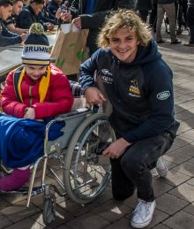 The Brumbies squad at Garema Place to meet the fans and sign posters ahead of a quarter-final match.