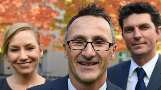 Greens leader Richard Di Natale (centre) has lost two of his senators to dual-citizenship confusion, Larissa Waters and ...