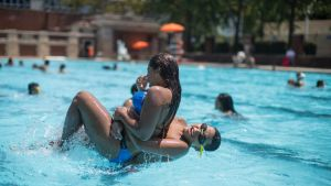 Teenagers cool off at the Hamilton Fish pool, Tuesday, July 18, 2017, in the Lower East Side neighborhood of Manhattan. ...