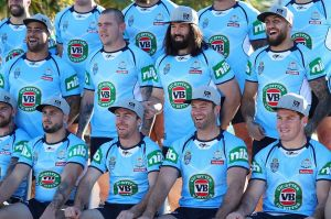 Hat trick: NSW Blues players pose for the team photo wearing their RLPA hats.